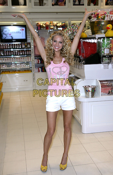 KRISTEN DALTON, MISS USA 2009.Unveils the new MISS USA Couture Pop at the Sugar Factory inside Miracle Mile Shops  at the Planet Hollywood Resort Hotel and Casino, Las Vegas, Nevada, USA, 6th May 2010..full length sash pink vest top sleeveless  white shorts yellow wedges arms raised up .CAP/ADM/MJT.© MJT/AdMedia/Capital Pictures.