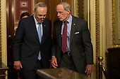 United States Senate Minority Leader Charles Schumer (Democrat of New York) left, and US Senator Tom Carper (Democrat of Delaware) exit a Democratic Caucus meeting shortly before a scheduled vote on a night when Congress tries to pass a spending bill to avoid a government shutdown in Washington, D.C. on January 19th, 2018. <br />