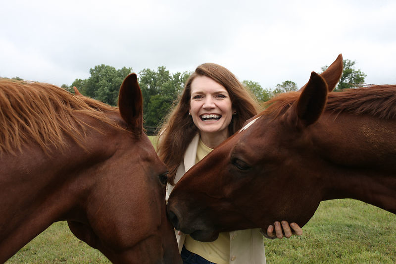 "{September 18, 2009} {11am} -- Culpeper, VA. -- Author Jeannette Walls poses with her horses Yaeger, left, and Jackson, right, at her farm in Culpeper, VA. Walls has written a book called ""Half-Broke Horses: A True Life Novel."" The book is about her grandmother who was a wild west woman who broke horses.. -- ...Photo by Andrew B. Shurtleff, Freelance."