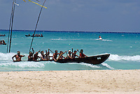 Canoes and paddlers arriving on the beach at Playa del Carmen or Xamanha during the Sacred Mayan Journey 2011 event, Riviera Maya, Quintana Roo, Mexico