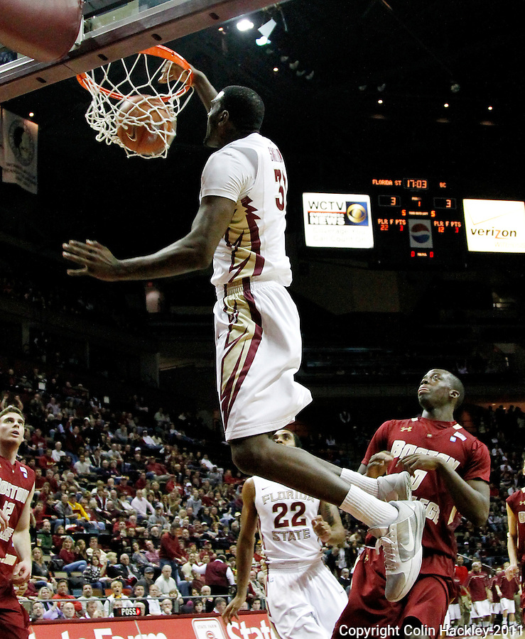 TALLAHASSEE, FL /1/22/11-FSU-BC MBB11 CH-Florida State's Chris Singleton dunks of a steal made by Derwin Kitchen agaisnt Boston College during first half action Saturday at the Donald L. Tucker Center in Tallahassee...COLIN HACKLEY PHOTO