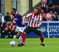 Lincoln City's Michael Bostwick vies for possession with Exeter City's Hiram Boateng<br /> <br /> Photographer Andrew Vaughan/CameraSport<br /> <br /> The EFL Sky Bet League Two Play Off First Leg - Lincoln City v Exeter City - Saturday 12th May 2018 - Sincil Bank - Lincoln<br /> <br /> World Copyright &copy; 2018 CameraSport. All rights reserved. 43 Linden Ave. Countesthorpe. Leicester. England. LE8 5PG - Tel: +44 (0) 116 277 4147 - admin@camerasport.com - www.camerasport.com