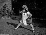 Wilkinsburg PA: Sally Stewart playing baseball in the backyard with her brother Brady - 1928