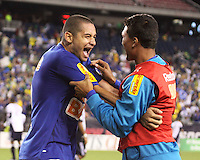 Cruzeiro forward Wellington Paulista celebrates with a teamate after scoring his third goal for the night.  Brazil's Cruzeiro beat the New England Revolution, 3-0 in a friendly match at Gillette Stadium on June 13, 2010