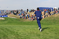 Rory McIlroy (Team Europe) races to the 3rd tee during the Friday Foursomes at the Ryder Cup, Le Golf National, Ile-de-France, France. 28/09/2018.<br /> Picture Thos Caffrey / Golffile.ie<br /> <br /> All photo usage must carry mandatory copyright credit (© Golffile | Thos Caffrey)