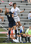 Marquette's Christy Zwolski (4) and Duke's Rachel-Rose Cohen (9) challenge for a header on Sunday September 17th, 2006 at Koskinen Stadium on the campus of the Duke University in Durham, North Carolina. The Duke Blue Devils and Marquette Golden Eagles tied 1-1 after overtime in an NCAA Division I Women's Soccer game.