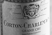 Closeup close-up of a wine bottle label Maison Louis Jadot Corton Charlemagne Grand Cru Appellation Controlee with the Baccus Bacchus symbol of the producer founded in 1859, Maison Louis Jadot, Beaune Côte Cote d Or Bourgogne Burgundy Burgundian France French Europe European