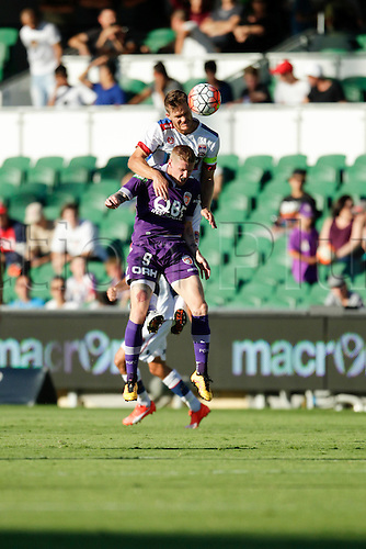 07.03.2016, Perth, Australia. Hyundai A-League, Perth Glory versus Newcastle Jets. Nigel Boogaard wins the header against Andy Keogh.