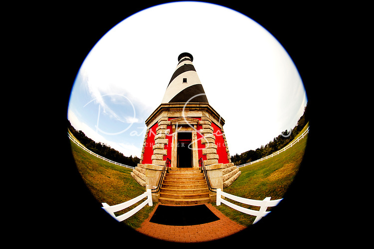The Cape Hatteras Lighthouse not only is the tallest in the nation, it's also one of the most recognized American lighthouses and a famous symbol of North Carolina. Cape Hatteras is one of the few North Carolina lighthouses where visitors can climb the inside stairs to the top. Cape Hatteras has white and black spiral bands and a red brick base. The lighthouse's beacon of light can be seen some 20-miles out to sea and has warned sailors for more than 100 years about the treacherous Diamond Shoals, the shallow sandbars which extend some 14 miles out into the ocean off Cape Hatteras. Charlotte NC photographer Patrick Schneider has extensive photo collections of the following lighthouses: Bodie Island Lighthouse, Bald Head Island Lighthouse, Cape Fear Lighthouse, Cape Hatteras Lighthouse, Cape Lookout Lighthouse, Currituck Beach Lighthouse, Diamond Shoal Lighthouse, Federal Point Lighthouse, Oak Island Lighthouse, and Ocracoke Lighthouse on Ocracoke Island.