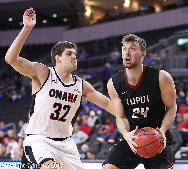 SIOUX FALLS, SD: MARCH 6: Evan Hall #24 of IUPUI drives on Daniel Meyer #32 of Omaha during the Summit League Basketball Championship on March 6, 2017 at the Denny Sanford Premier Center in Sioux Falls, SD. (Photo by Dick Carlson/Inertia)
