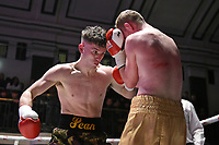 Sean Robinson (green shorts) defeats William Warburton during a Boxing Show at York Hall on 3rd March 2018