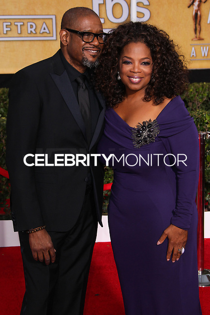 LOS ANGELES, CA - JANUARY 18: Forest Whitaker, Oprah Winfrey at the 20th Annual Screen Actors Guild Awards held at The Shrine Auditorium on January 18, 2014 in Los Angeles, California. (Photo by Xavier Collin/Celebrity Monitor)