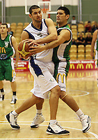 Manawatu captain Kane Hokianga (right) tries to get the ball off Auckland import Blagoj Janev during the NBL Round 5 match between the Manawatu Jets  and Auckland Stars at Arena Manawatu, Palmerston North, New Zealand on Friday 10 April 2009. Photo: Dave Lintott / lintottphoto.co.nz
