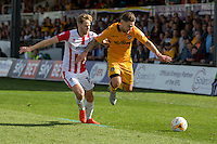 Asa Hall of Cheltenham and Jack Compton of Newport County during the Sky Bet League 2 match between Newport County and Cheltenham Town at Rodney Parade, Newport, Wales on 10 September 2016. Photo by Mark  Hawkins / PRiME Media Images.