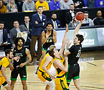 SIOUX FALLS, SD - MARCH 10: Filip Rebraca #12 of the North Dakota Fighting Hawks shoots over a North Dakota State defender during the men's championship game at the 2020 Summit League Basketball Tournament in Sioux Falls, SD. (Photo by Richard Carlson/Inertia)