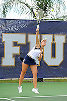 18 March 2012:  FIU's Giulietta Boha serves the ball during her doubles match against Columbia's Nicole Bartnik and Lani Alecsiu as the Columbia Lions defeated the FIU Golden Panthers, 5-2, at University Park in Miami, Florida.