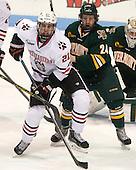 Nolan Stevens (NU - 21), Chris Muscoby (UVM - 24) - The visiting University of Vermont Catamounts defeated the Northeastern University Huskies 6-2 on Saturday, October 11, 2014, at Matthews Arena in Boston, Massachusetts.