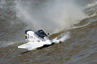 """2004 Bay City River Roar, Bay City, Michigan, 26-27 June, 2004..Frame 3: begins to """"land"""" nose down..........Bill Joule launches off of one of the """"Bay City rollers"""", the boat hooks hard to the left, submarines the right sponson, and barrel rolls. First the right sponson is torn away followed by the left. Joule can be seen in the cockpit during the crash. The hull came to rest in three pieces, Joule escaped the the cockpit under his own power without injury...©F. Peirce Williams 2004..F. Peirce Williams .photography.P.O. Box 455 Eaton, Ohio 45320 USA.p: 317.358.7326 e: fpwp@mac.com"""