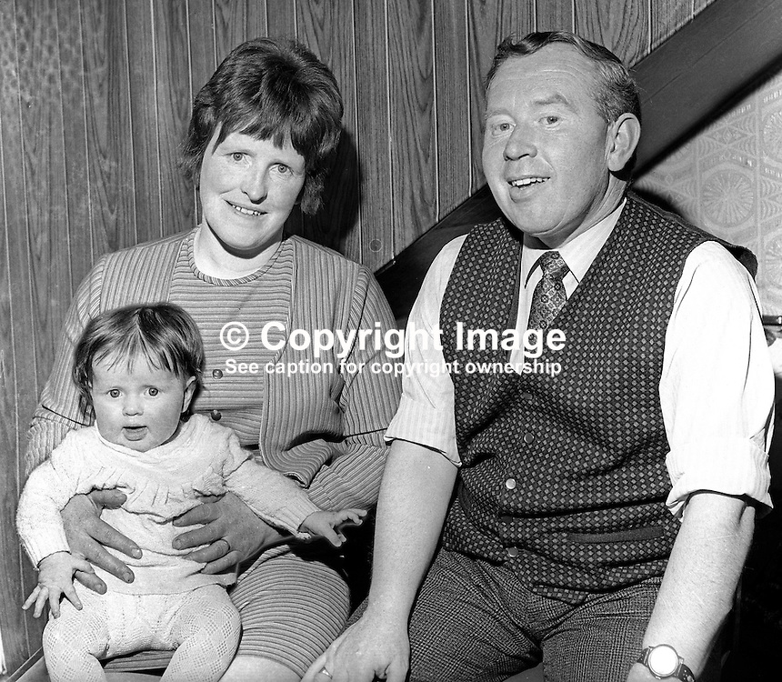 Patrick Joseph McClean, from Beragh, Omagh, Co Tyrone, N Ireland, UK, who was one of 342 men interned in 1971 during the N Ireland Troubles. He was a prominent member of the N Ireland Civil Rights Association. He is pictured here re-united with his wife and 8 months old daughter, Orla, in May 1972.  197205000331.<br />