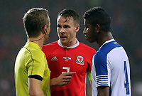 (L-R) Referee Bart Vertenten speaks with Chris Gunter of Wales and Fidel Escobar of Panama who is protesting for awarding a penalty to Wales during the international friendly soccer match between Wales and Panama at Cardiff City Stadium, Cardiff, Wales, UK. Tuesday 14 November 2017.