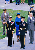 Princess Diana, center in blue dress, looks on as her husband Prince Charles, left center, arrives to lay a wreath at the Tomb of the Unknowns in observance of Veterans Day at Arlington National Cemetery in Arlington, Virginia on November 11, 1985.<br /> Credit: Arnie Sachs / CNP
