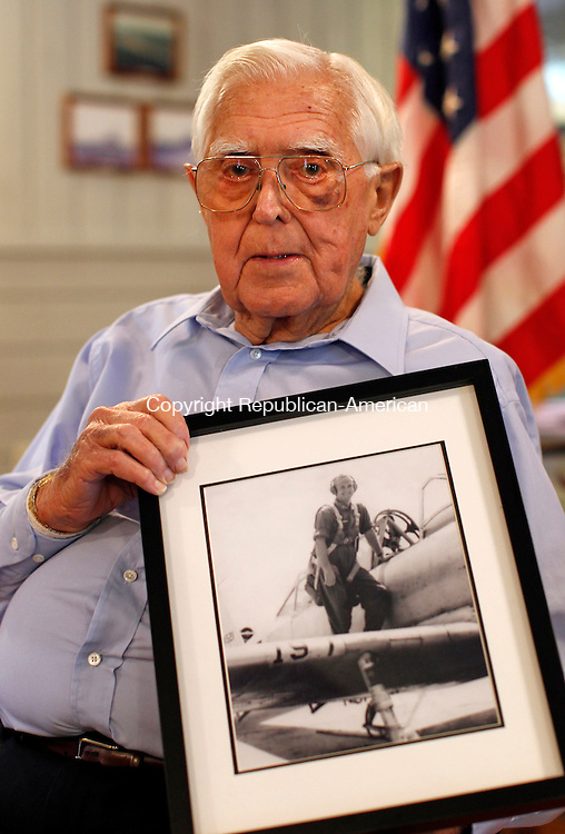 Southbury, CT- 15, August 2010-081510CM07  Richard Hine, a member of the American Legion Post 147 in Southbury, donated this picture of his brother, Lt. Edward Hine, who was killed in a training exercise in 1947 Texas.  A rededication ceremony was held at the post in Southbury Sunday afternoon honoring Lt. Hine.  Christopher Massa Republican-American