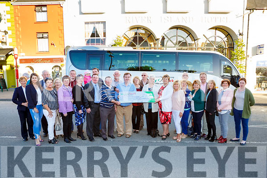 The hard working fundraisers presents a cheque of €18510 to buy the new Cork Kerry Health link bus presented the bus to the charity in Castleisland on Tuesday evening