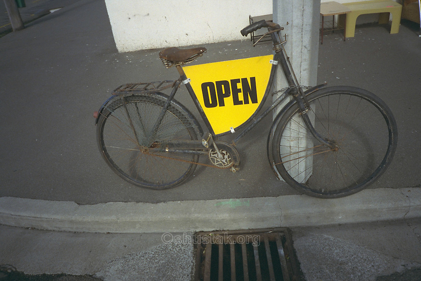 Open sign on bicycle, Christchurch, New Zealand.