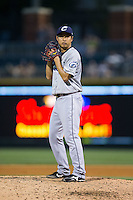 Columbus Clippers starting pitcher Toru Murata (17) looks to his catcher for the sign against the Charlotte Knights at BB&T BallPark on May 27, 2015 in Charlotte, North Carolina.  The Clippers defeated the Knights 9-3.  (Brian Westerholt/Four Seam Images)