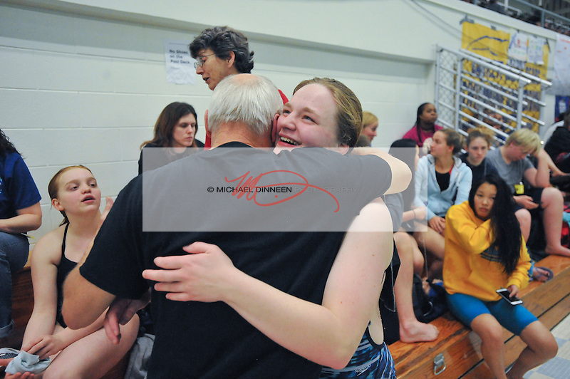 Chugiak's Annika Yancey hugs coach Larry Smth following her dives inteh Region IV Swim Championships finals.  Photo for the Star by Michael Dinneen