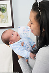 Newborn baby boy responding to mother talking and smiling