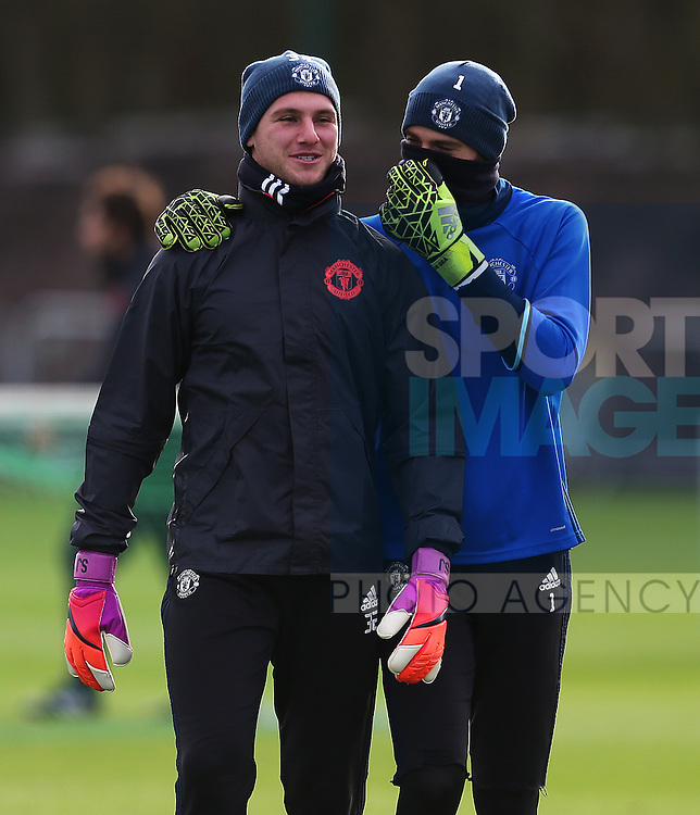 David De Gea of Manchester United talks with Sam Johnstone during the UEFA Europa League training session at the AON Training Complex, Manchester. Picture date: November 23rd 2016. Pic Matt McNulty/Sportimage