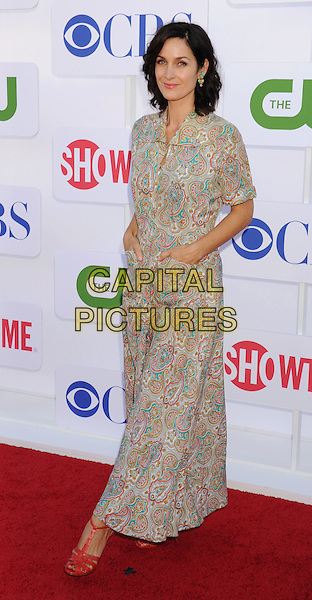 Carrie-Anne Moss.CBS, CW, Showtime 2012 Summer TCA Party held at The Beverly Hilton Hotel, Beverly Hills, California, USA..July 29th, 2012.full length dress red sandals white blue pink paisley print turquoise hands in pockets .CAP/ROT/TM.©Tony Michaels/Roth Stock/Capital Pictures