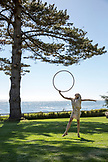 USA, California, Big Sur, Esalen, hula hooping on the lawn by the Lodge in front of the Pacific Ocean, the Esalen Institute