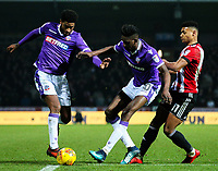Bolton Wanderers' Mark Little and Sammy Ameobi battles with Brentford's Ollie Watkins<br /> <br /> Photographer Alex Dodd/CameraSport<br /> <br /> The EFL Sky Bet Championship - Brentford v Bolton Wanderers - Saturday 13th January 2018 - Griffin Park - Brentford<br /> <br /> World Copyright &copy; 2018 CameraSport. All rights reserved. 43 Linden Ave. Countesthorpe. Leicester. England. LE8 5PG - Tel: +44 (0) 116 277 4147 - admin@camerasport.com - www.camerasport.com
