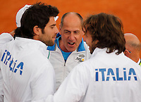 Italy's  Corrado Barazzutti celebrate  after winning    Davis Cup quarter-final tennis match against Britainy and qualify for semifinal  in Naples April 6, 2014.