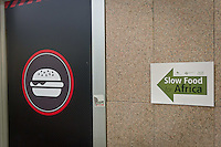 The banner of slow food vs Fast Food logo out side of the Slow Food Foundation for Biodiversity a thousand gardens in Africa in February 17, 2014. Photo: Adamo Di Loreto/BuenaVista*photo