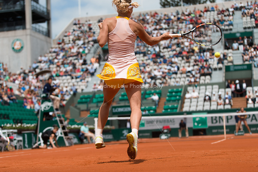May 26, 2015: Caroline Wozniacki (DEN) in action in a 1st round match against Karin Knapp (ITA) on day three of the 2015 French Open tennis tournament at Roland Garros in Paris, France. Sydney Low/AsteriskImages