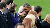 United States President Barack Obama comforts families of the victims at a memorial for the victims of the Washington Navy Yard shooting at the Marine Barracks, September 22, 2013 in Washington, D.C.  The President and first lady also visited with families of the victims. <br /> Credit: Olivier Douliery / Pool via CNP