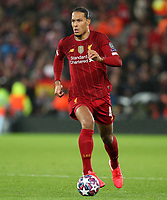 11th March 2020; Anfield, Liverpool, Merseyside, England; UEFA Champions League, Liverpool versus Atletico Madrid;  Virgil van Dijk of Liverpool runs with the ball at his feet