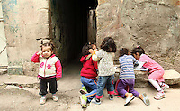 19.04.12 A group of children play in the backstreets of Armanaz, Northern Syria.