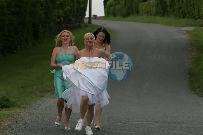 Bride Christine Evans, with Bridesmaids Carassa McDonell  and Emma Brennan in there wedding gear getting ready for the womans mini marathon the day after Christine gets married..Photo: Newsfile/Fran Caffrey.