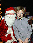 Ben Maguire pictured with santa at the Mell children's Christmas party. Photo:Colin Bell/pressphotos.ie