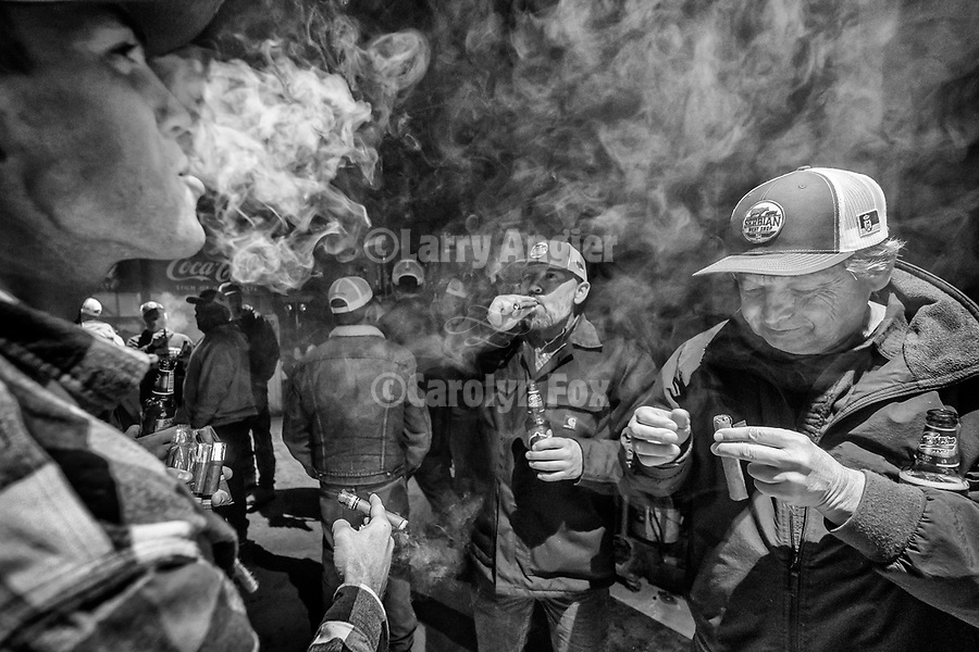 """Smoking Cuban cigars at the end of the """"shift"""", Serbian Meat Shop crew of Amador County prepares and stuffs their Srpska kobasica– Serbian domestic sausage–using their secret recipe and methods during their annual winter gathering."""