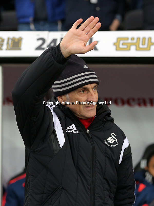 Swansea head coach Francesco Guidolin thanks home supporters for their welcome during the Barclays Premier League match between Swansea City and Crystal Palace at the Liberty Stadium, Swansea on February 06 2016