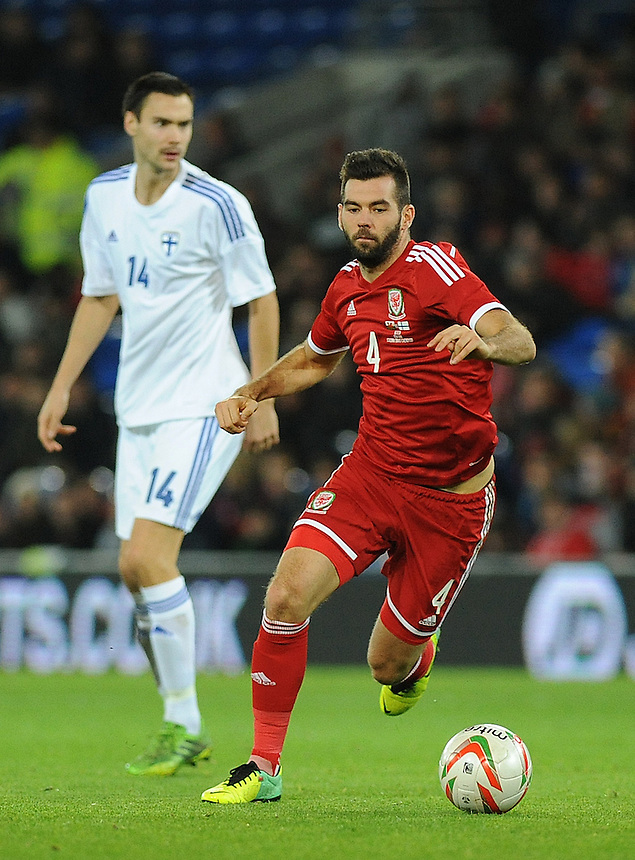 Wales Joe Ledley in action during todays match  <br /> <br /> Photo by Ashley Crowden/CameraSport<br /> <br /> Football - International Friendly - Wales v Finland - Saturday 16th November 2013 - Cardiff City Stadium - Cardiff<br /> <br /> &copy; CameraSport - 43 Linden Ave. Countesthorpe. Leicester. England. LE8 5PG - Tel: +44 (0) 116 277 4147 - admin@camerasport.com - www.camerasport.com