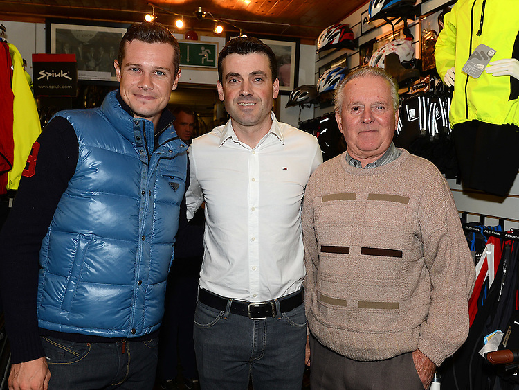 Proprietor Austin Walsh and his dad Tommy pictured with Fifth overall and a stage winner in the Vuelta a Espana (Tour of Spain) Nicolas Roche when he paid a visit to Quay Cycles Drogheda. Photo:Colin Bell/pressphotos.ie