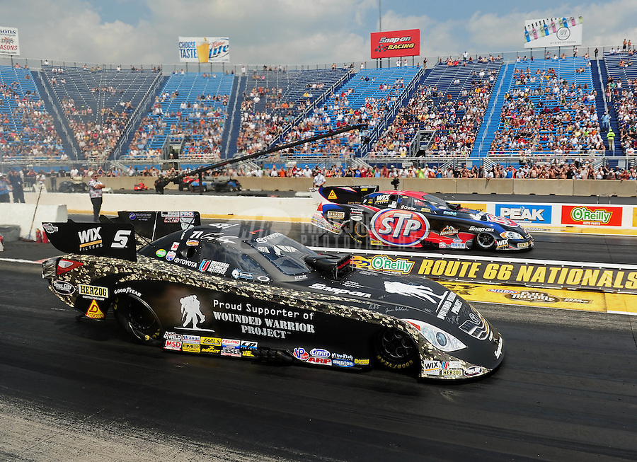 Jul, 10, 2011; Joliet, IL, USA: NHRA funny car driver Cruz Pedregon (near lane) alongside bother Tony Pedregon during the Route 66 Nationals at Route 66 Raceway. Mandatory Credit: Mark J. Rebilas-