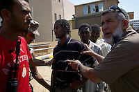 Tripoli, Libya, August 27, 2011.Rebel troops round up suspected Khaddafi mercenaries in a east Tripoli prison; some still carry their mercenary ID's on them..