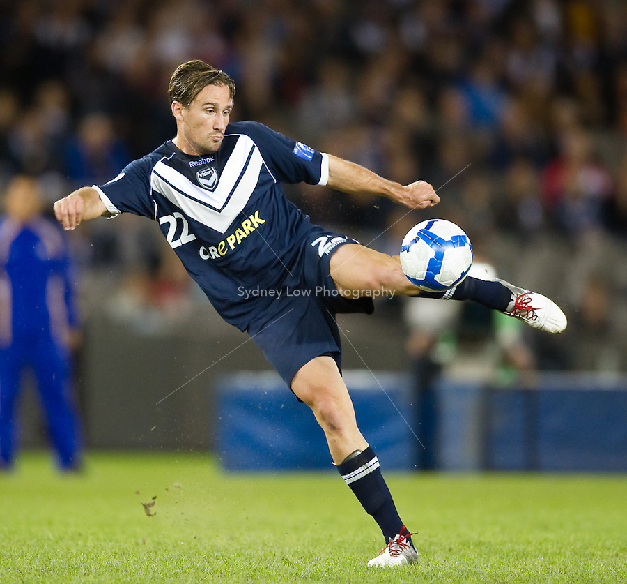 MELBOURNE, AUSTRALIA - MARCH 09, 2010: Nick Ward of Melbourne Victory kicks for goal during the AFC Champions League Group E match between the Melbourne Victory and Seongnam Ilhwa Chunma at Etihad Stadium on March 9, 2010 in Melbourne, Australia. Photo Sydney Low www.syd-low.com